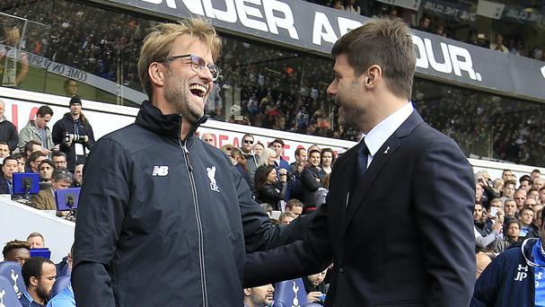 Jurgen Klopp, pictured left, has tried to put the pressure on Mauricio Pochettino, pictured right, ahead of Saturday's game