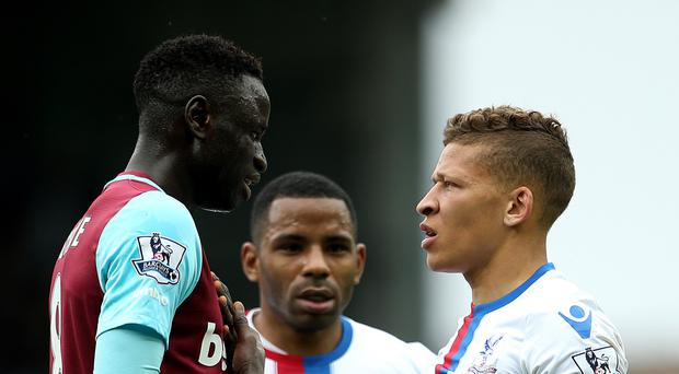 Cheikhou Kouyate, left, was given his marching orders against Crystal Palace