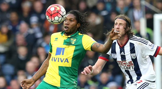 Dieumerci Mbokani (left) was back in action with Norwich after missing Congo's African Nations Cup qualifiers