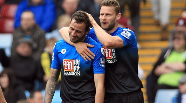 Bournemouth's Steve Cook, left, was on target in the victory over Aston Villa
