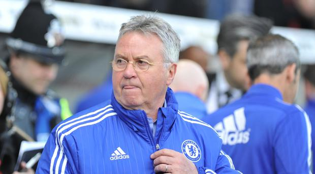 Chelsea interim manager Guus Hiddink said his first league defeat was not down to players being distracted by news of Antonio Conte's appointment next season.