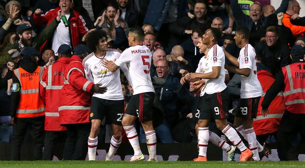 Manchester United's Marouane Fellaini (left) celebrates the second goal against West Ham