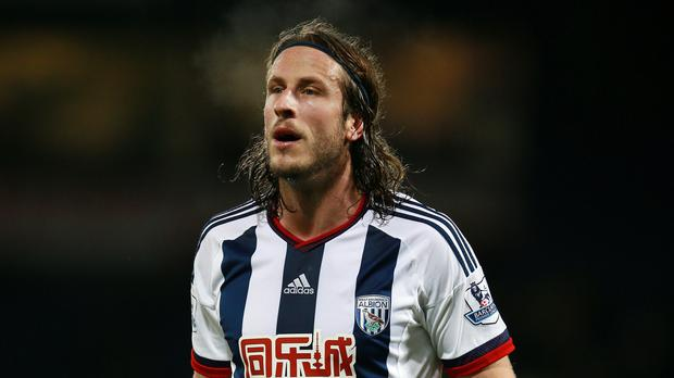 Jonas Olsson, pictured, has signed a contract extension at West Brom alongside Gareth McAuley