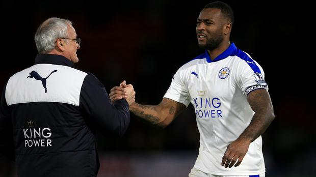 Leicester captain Wes Morgan, right, is on the brink of lifting the Premier League title