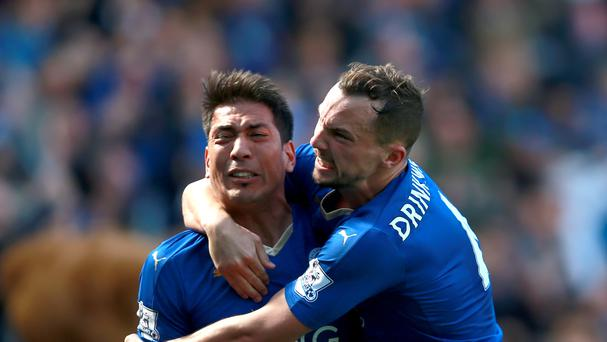 Leonardo Ulloa, left, celebrates with Daniel Drinkwater after scoring Leicester's second goal from the penalty spot