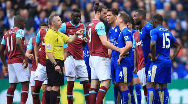 West Ham's Andy Carroll, centre, was furious with referee Jonathan Moss' display against Leicester