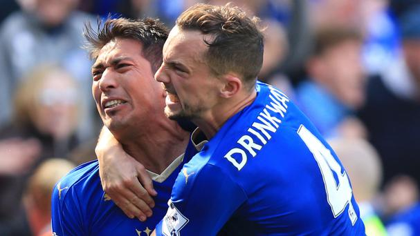 Leonardo Ulloa, left, celebrates with Danny Drinkwater after his injury-time penalty earned Leicester a 2-2 draw with West Ham