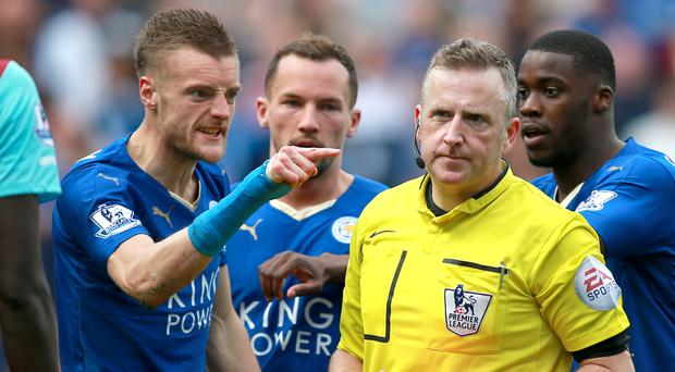 Leicester's Jamie Vardy, left, shows his anger after he is shown a second yellow card for diving by referee Jonathan Moss back in April