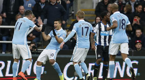 Manchester City's Sergio Aguero, second from left, celebrates his 100th Premier League goal