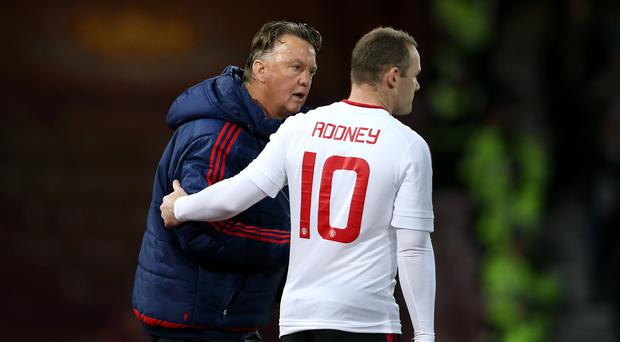 Manchester United manager Louis van Gaal (left) says Wayne Rooney can secure an FA Cup semi-final place