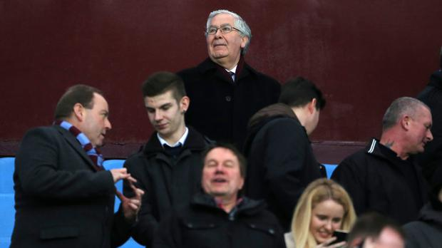 Mervyn King, back, stepped down from the Aston Villa board on Monday