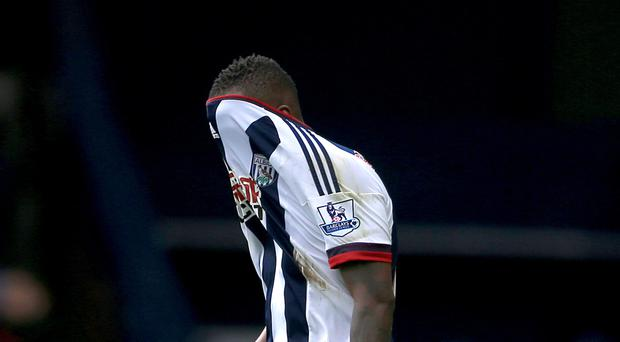 West Brom striker Saido Berahino hides his face after seeing one of two penalties saved by Watford keeper Heurelho Gomes
