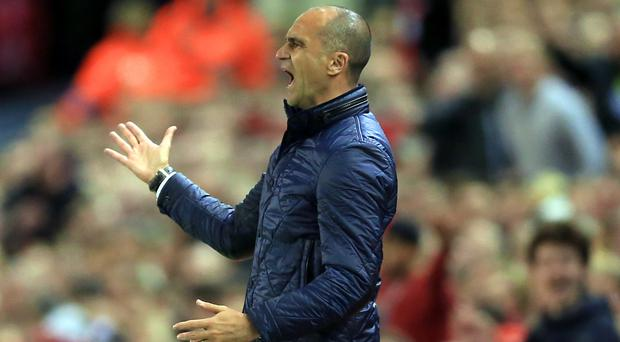 Roberto Martinez's Everton suffered a 4-0 defeat at Liverpool