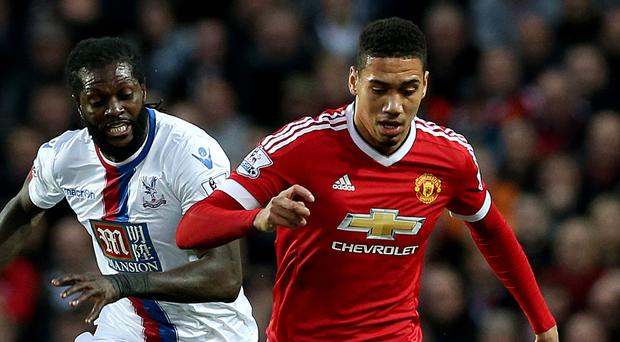 Manchester United's Chris Smalling, right, had a quiet night against Crystal Palace