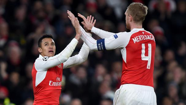 Per Mertesacker, right, admits Alexis Sanchez's two-month injury absence at the turn of the year hit Arsenal hard