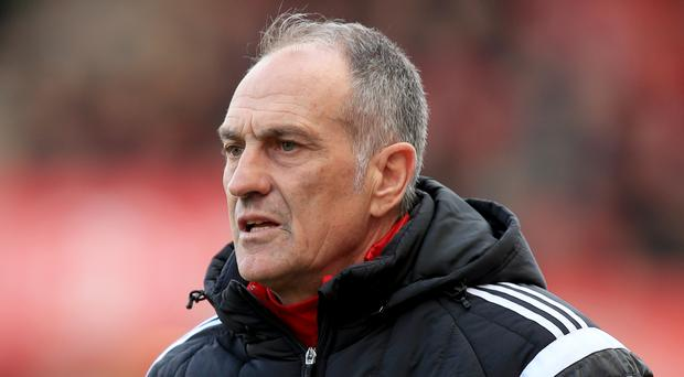 Swansea head coach Francesco Guidolin, pictured, is aiming to stop the title charge of his friend and Leicester manager Claudio Ranieri