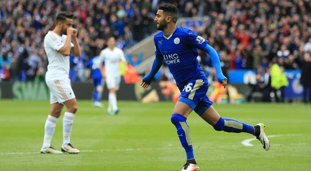Riyad Mahrez celebrates after opening the scoring