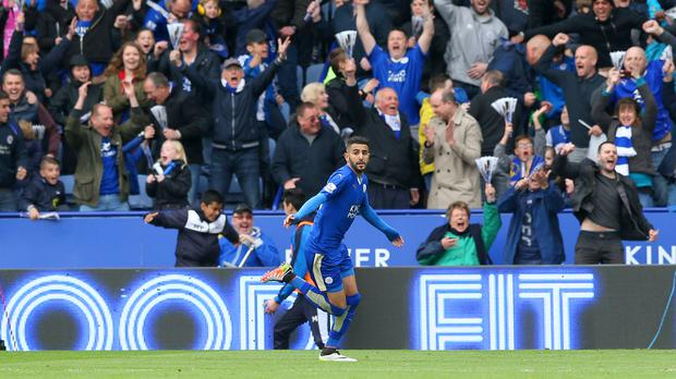 Leicester's Riyad Mahrez celebrates opening the scoring in their 4-0 win over Swansea