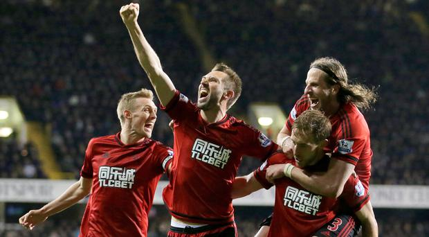 West Brom's Craig Dawson, second right, celebrates with his team-mates after scoring the equaliser