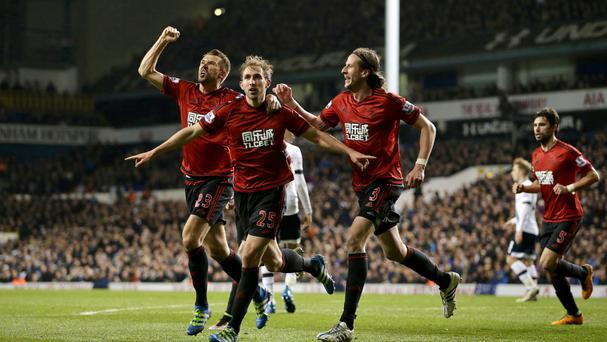West Brom's Craig Dawson (centre) celebrates his goal in the 1-1 draw at Tottenham, which left Spurs' title chances in tatters.