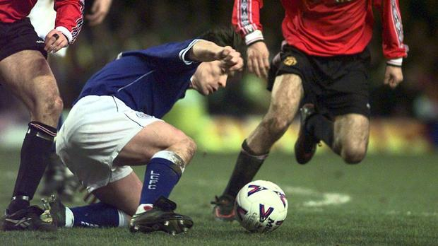 THIS PICTURE MAY ONLY BE USED WITHIN THE CONTEXT OF AN EDITORIAL FEATURE. Manchester United's Michel Beck and Ryan Giggs bring Leicester City's attack in the shape of Tony Cottee to its knees during the Carling Premiership at Filbert St.