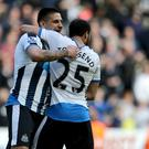 Andros Townsend celebrates with Aleksandar Mitrovic, left, after victory at St James' Park