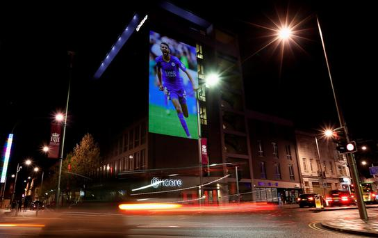 An image of Riyad Mahrez of Leicester City is projected onto the Ramada Encore hotel in Leicester. Photo: Getty