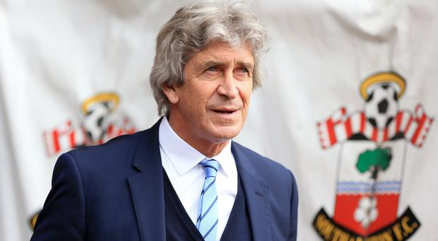 Manuel Pellegrini's Manchester City side are three points adrift of third-placed Arsenal