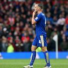 Danny Drinkwater walks dejectedly off the pitch after his red card at Old Trafford