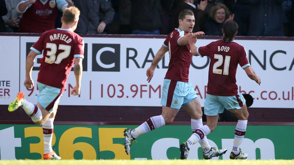 Burnley's Sam Vokes, centre, celebrates scoring his side's winner