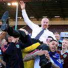 Sean Dyche is hoisted up by his Burnley players as they celebrate promotion
