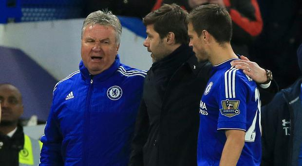 Guus Hiddink, left, ended the title hopes of Mauricio Pochettino, centre, and Tottenham