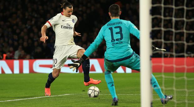 Thibaut Courtois, pictured right, has no intention of joining Paris St Germain