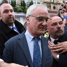 Leicester manager Claudio Ranieri is mobbed after a celebration lunch with his squad and the club's owners on Tuesday.