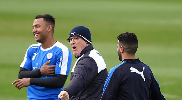Leicester manager Claudio Ranieri, centre, on the training pitch with his players after winning the Premier League