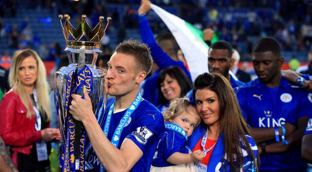 Leicester's Jamie Vardy scored twice against Everton before getting his hands on the Premier League trophy
