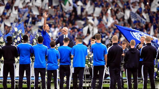 Andrea Bocelli performs next to Leicester City manager Claudio Ranieri