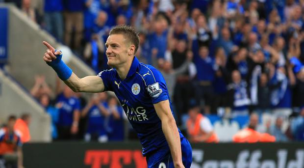 Leicester's Jamie Vardy celebrates making it 3-0 against Everton before the Foxes lifted the Barclays Premier League trophy.
