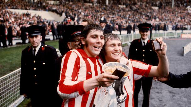 Matchwinner Ian Porterfield, pictured left with Dennis Tueart, parade the FA Cup at Wembley in 1973