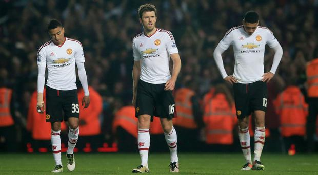Michael Carrick, centre, did not enjoy his return to former club West Ham