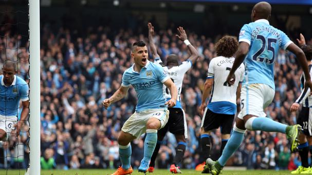 Sergio Aguero, left, scores one of five goals for Manchester City in their rout of Newcastle