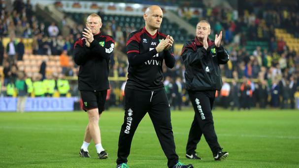 Alex Neil, centre, applauds the Norwich fans following confirmation of the club's relegation
