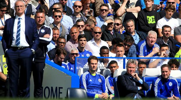 John Terry sat behind manager Guus Hiddink on the last day of the season