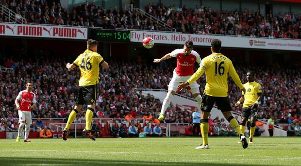 Olivier Giroud heads in the first of his three goals