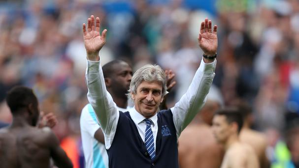 Manchester City manager Manuel Pellegrini waves goodbye after the 1-1 draw at Swansea.