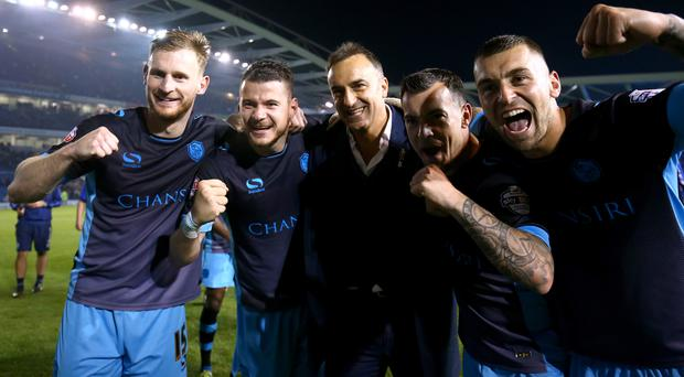 Carlos Carvalhal, centre, celebrates with his team after clinching a place at Wembley