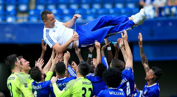 Chelsea captain John Terry, top, has agreed a contract extension to stay at Stamford Bridge for next season