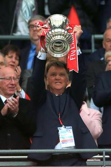 Louis van Gaal lifts the FA Cup. Photo: PA