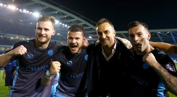Sheffield Wednesday coach Carlos Carvalhal, pictured second right celebrating with players after the play-off semi-final win over Brighton, has signed a new contract