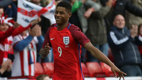 Marcus Rashford celebrates scoring on his England debut against Australia on Friday
